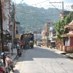 Streets of Old Pokhara with the Sarangkot in the background