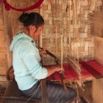 Tribe woman weaving a scarf